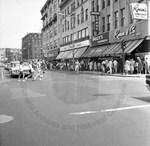 Sidewalk Sale on Main Street by Stanley Bauman